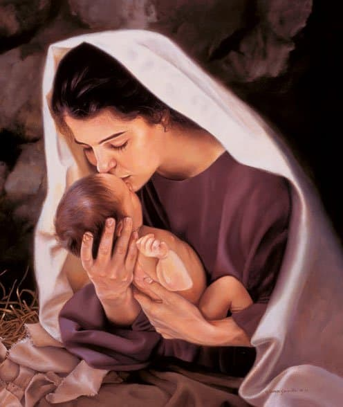 Madre María besando a un bebé