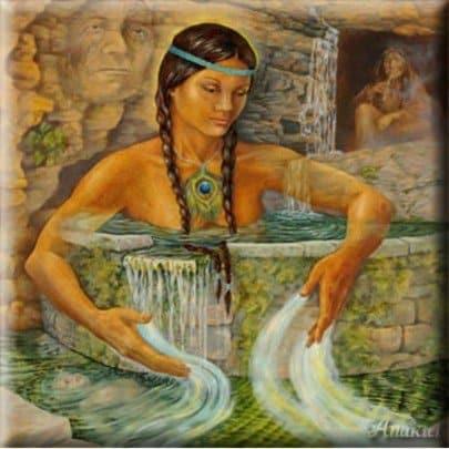 mujer india con la tierra en las manos