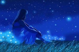 mujer sentada mirando las estrellas
