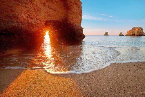 Puerta-del-Sol-en-la-playa-y-el-mar1