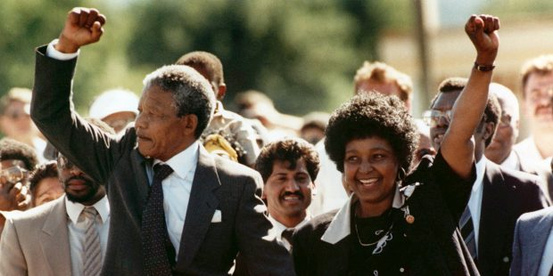 "FILE - In this Feb. 11, 1990 file photo, Nelson Mandela and his wife, Winnie Madikizela-Mandela, raise clenched fists as they walk hand-in-hand upon his release from prison in Cape Town, South Africa. Six years later, speaking during divorce proceedings, Mandela said with convincing calm: ""I'm determined to get rid of this marriage. It exists only on paper."" It was the end of a powerful political partnership, and of a romance made all the more poignant by the way it fell apart. South Africa's President Jacob Zuma says, Thursday, Dec. 5, 2013, that Nelson Mandela has died. He was 95. (AP Photo/Greg English, File)"