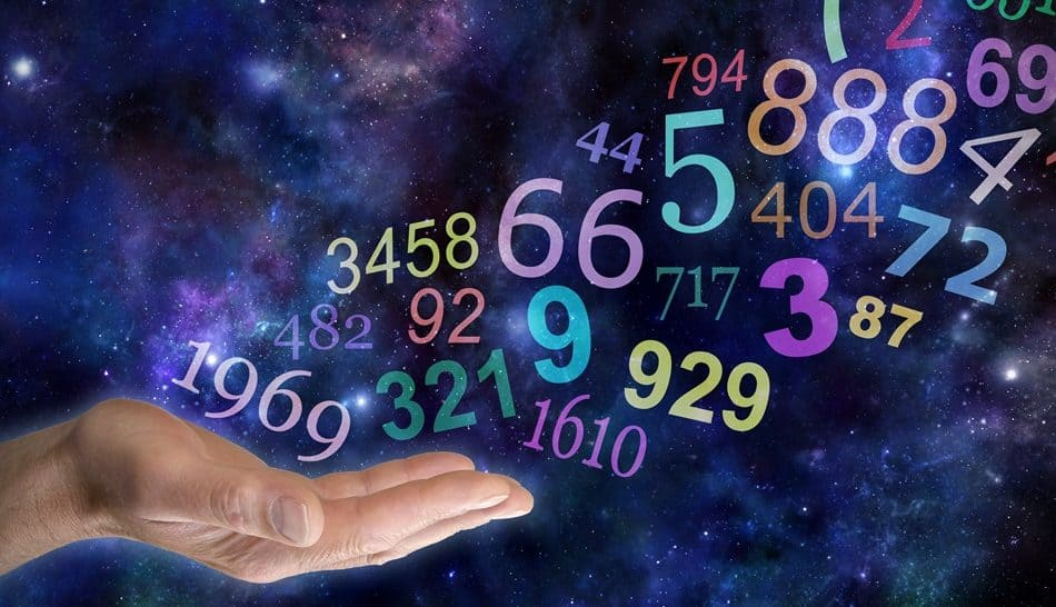 What do your Numbers mean – male hand palm up with a group   of random multicolored transparent numbers floating up and away on a wide deep space background with copy space - hermandadblanca.org
